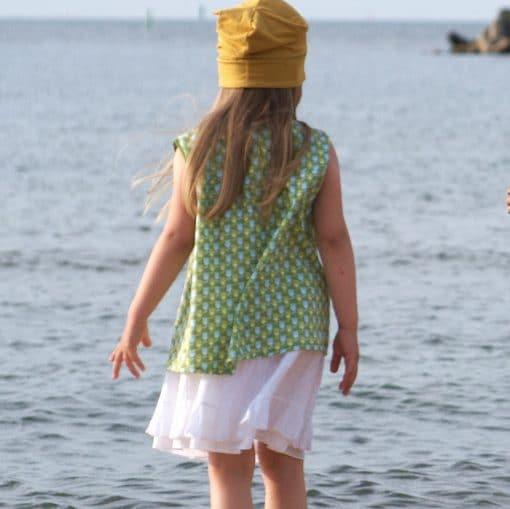 Rüschenrock und grüne Tunika für Mädchen